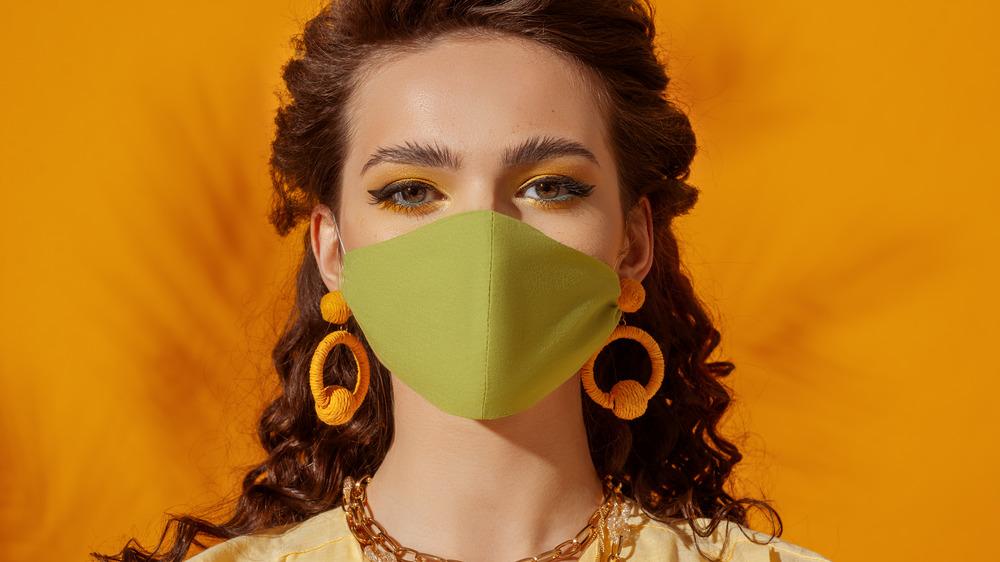 Woman wearing orange hoop earrings
