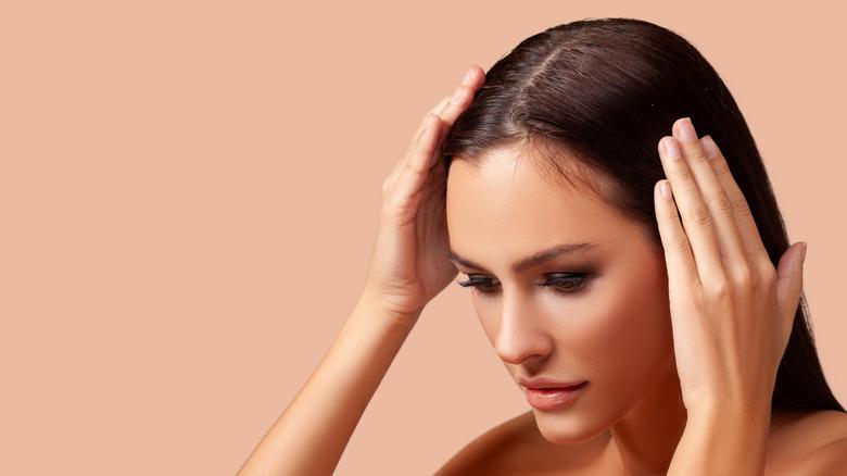 woman touching hair