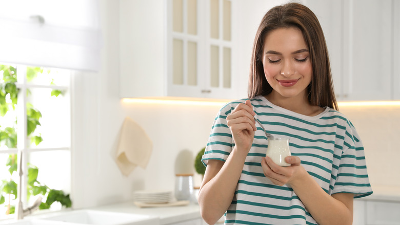 Young woman eating a healthy snack
