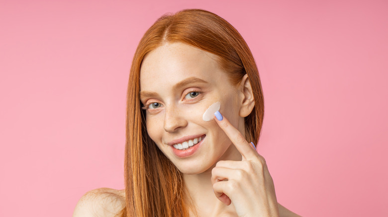 Woman putting on primer