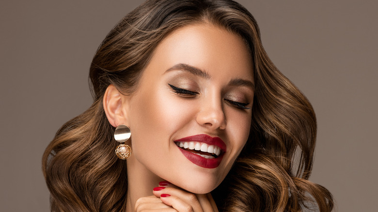 Heart-shaped face with pendant earrings