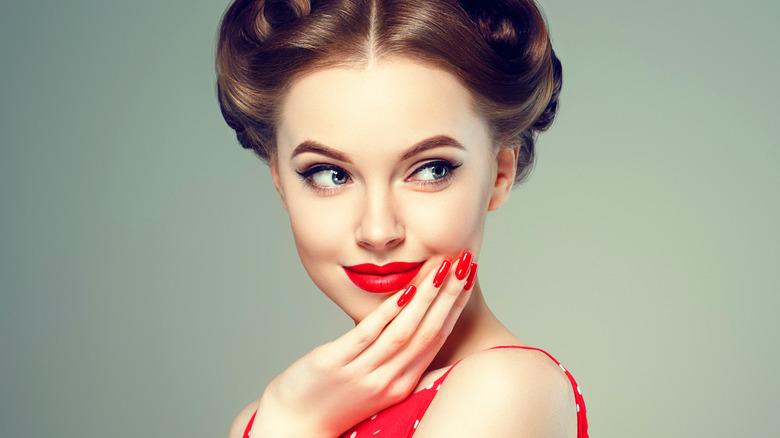 girl smiling in red polka dot dress