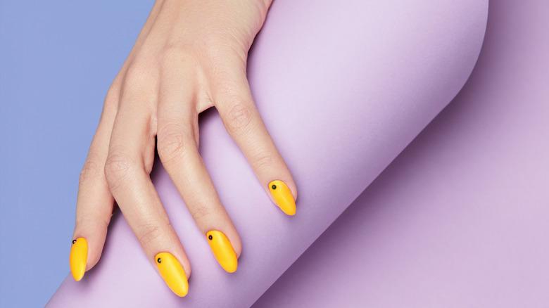 Nail art with yellow polish