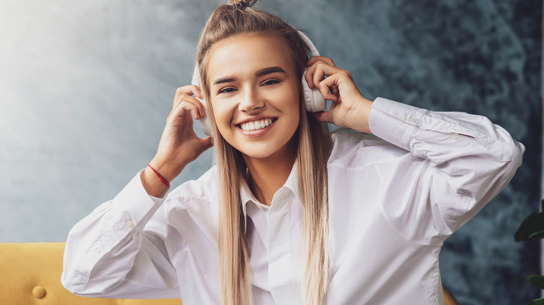 woman on couch headphones