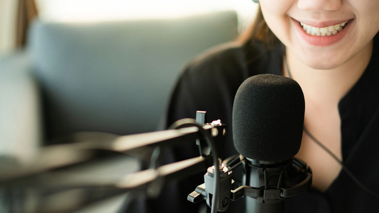 Woman at a podcast microphone