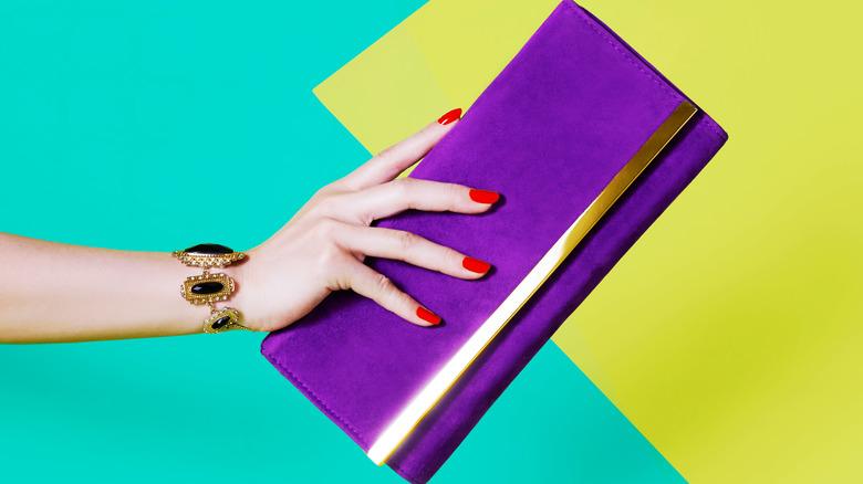 purple purse womens hand
