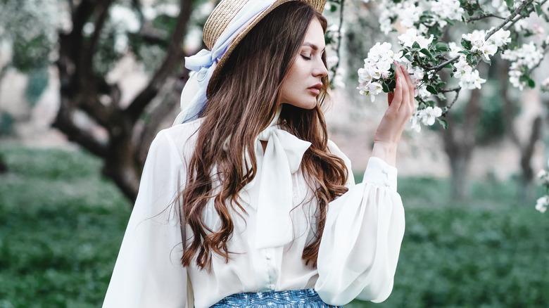 Woman in flowy white blouse