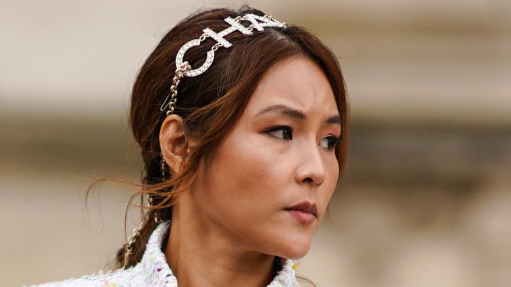 woman wearing Chanel headband