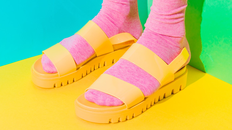 Pink socks with yellow sandals