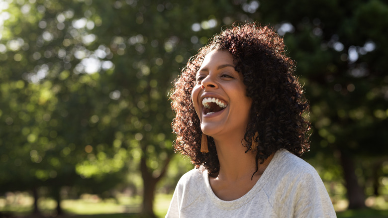 Woman laughing while outside in the sun