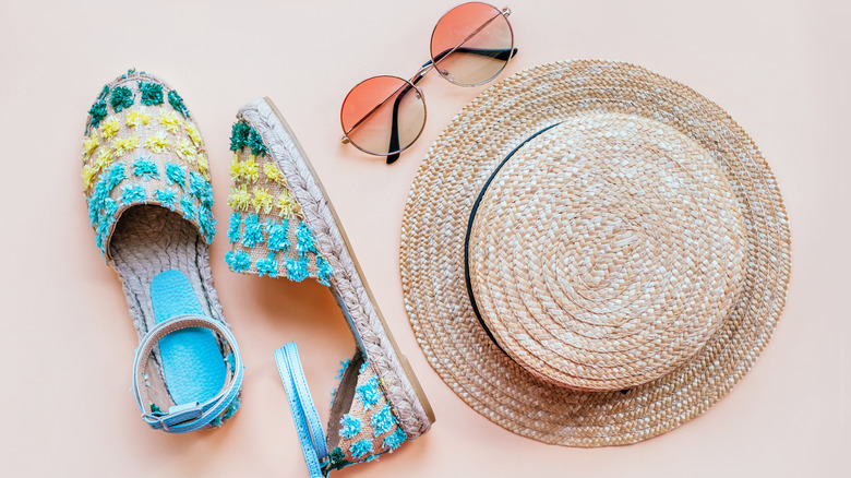 espadrille sandals, sunglasses, and a summer hat