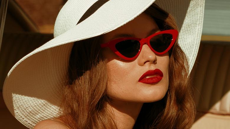 woman red sunglasses sunhat