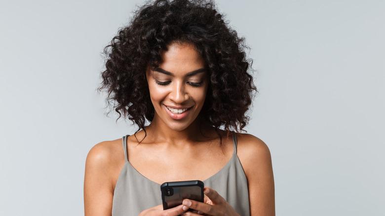 Woman swiping on her phone