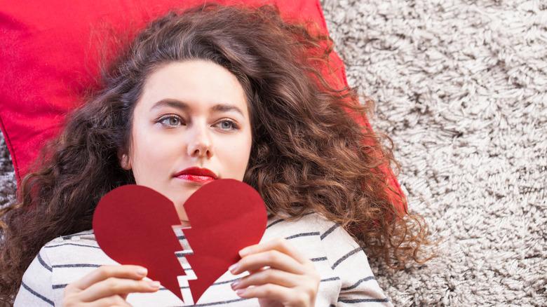 Woman holding broken heart