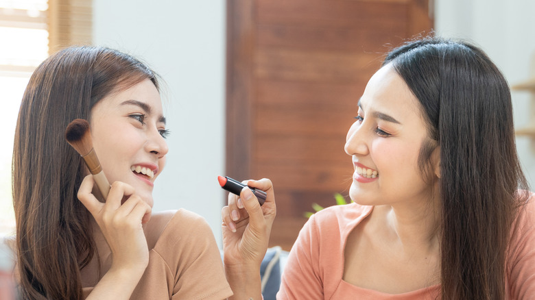 sharing makeup with friends