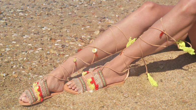 Woman wearing gladiator sandals