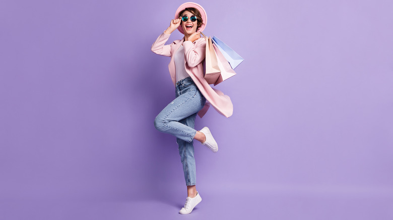 Woman with shopping bags wearing white sneakers
