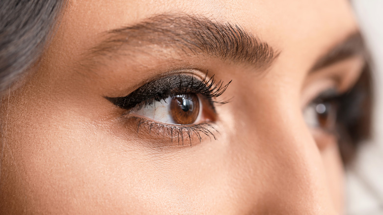 Woman showing winged eyeliner