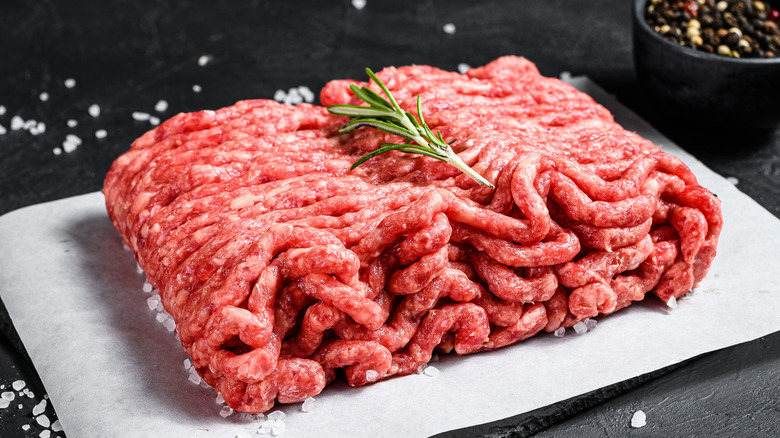 Ground beef sitting on a serving board