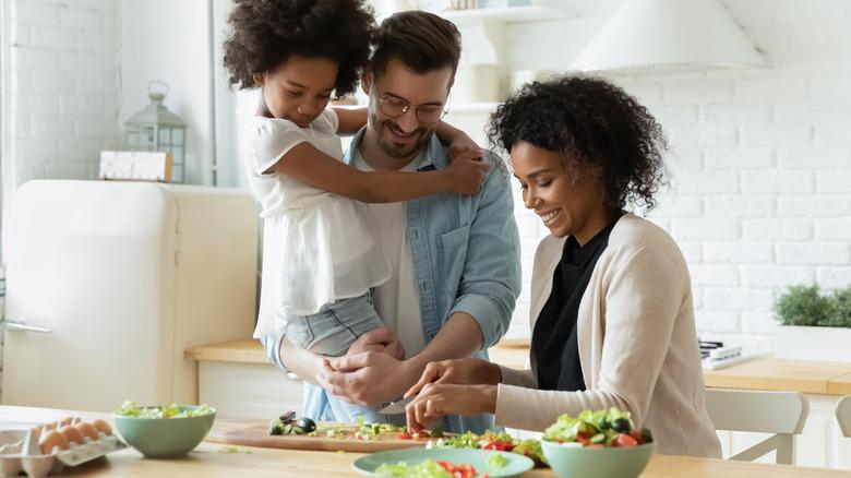Interracial family making a salad