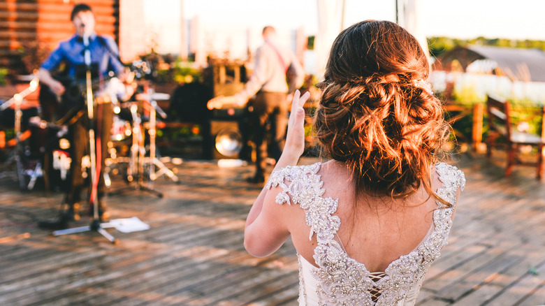 Bride clapping for her wedding band