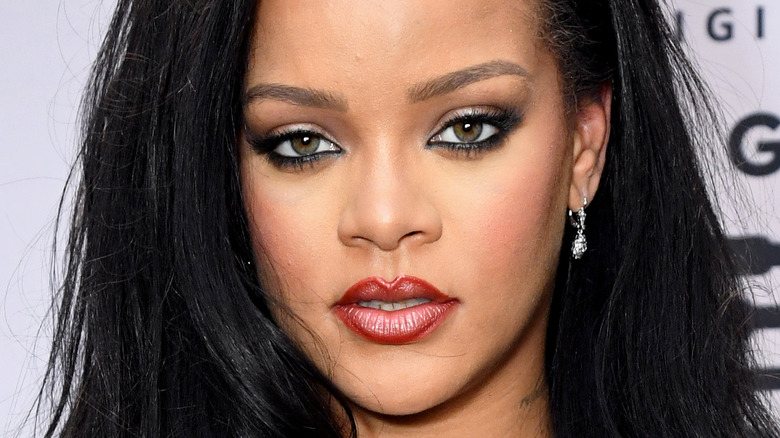 Rihanna poses at a Savage X Fenty event