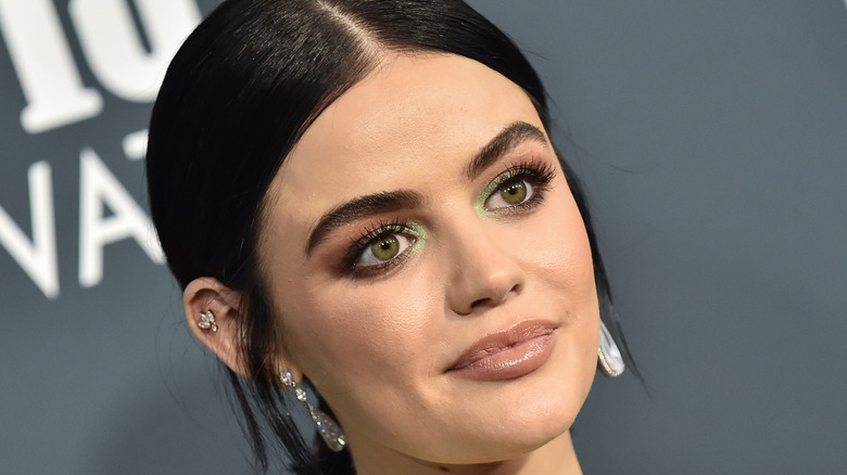Lucy Hale posing on the red carpet