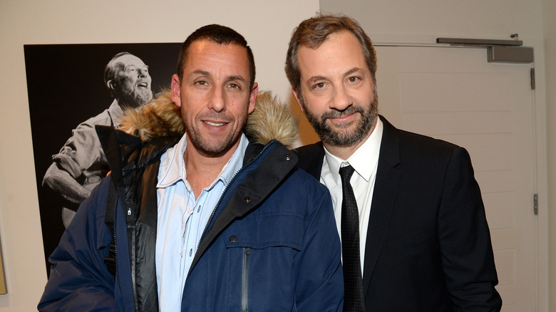Adam Sandler and Judd Apatow smile at an event