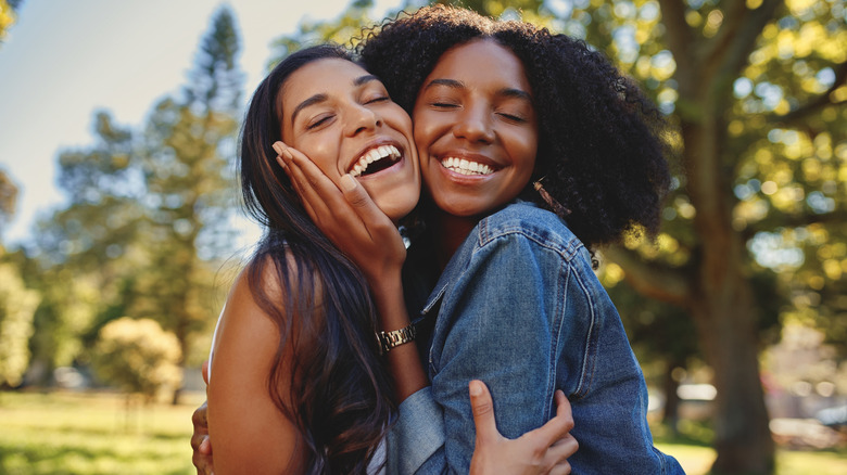 two women hugging friends