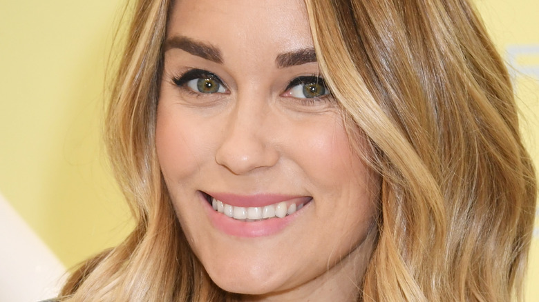 Lauren Conrad smiling for a picture at an event
