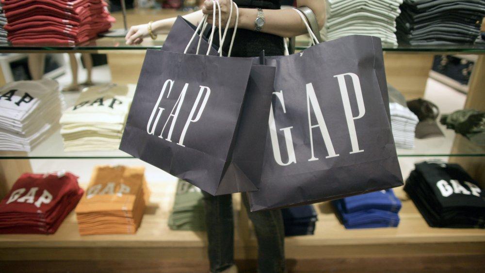 Woman carrying Gap bags