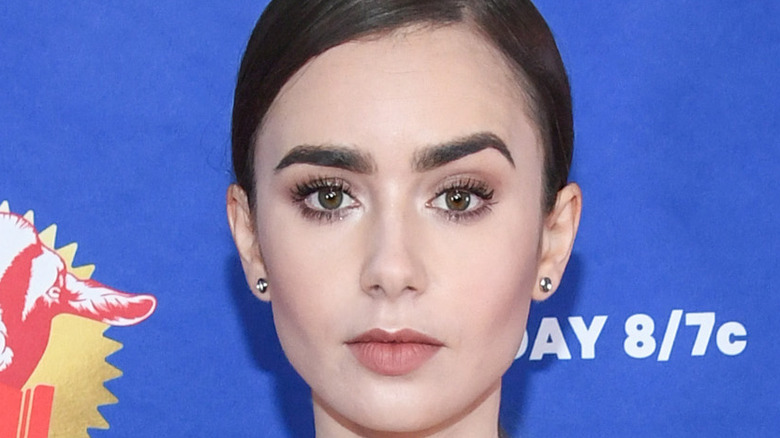 Lily Collins poses on the red carpet