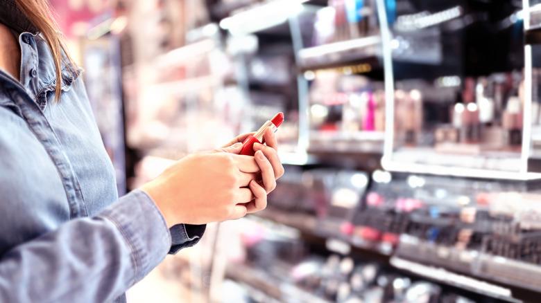 drugstore lipstick woman browsing
