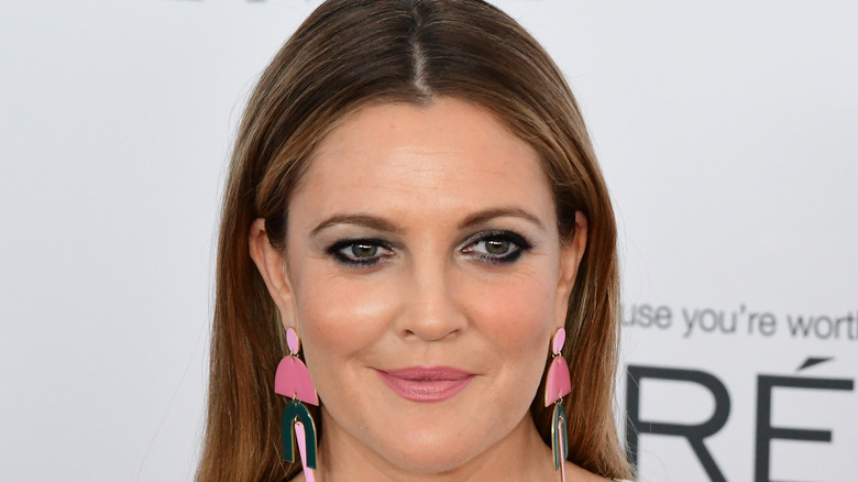 Drew Barrymore poses on the red carpet