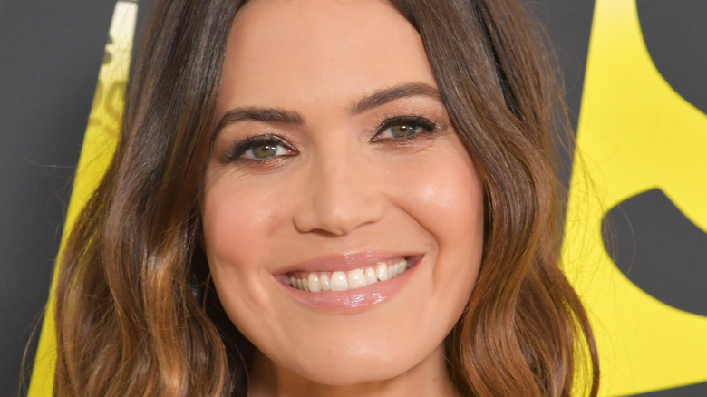 Mandy Moore smiles with dark ombre hair