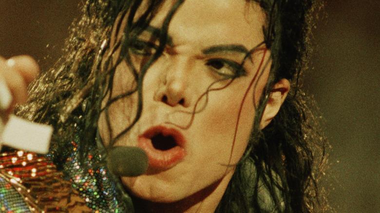 Michael Jackson singing at a concert