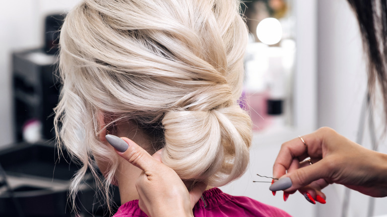 light blond hair tied back in a chignon