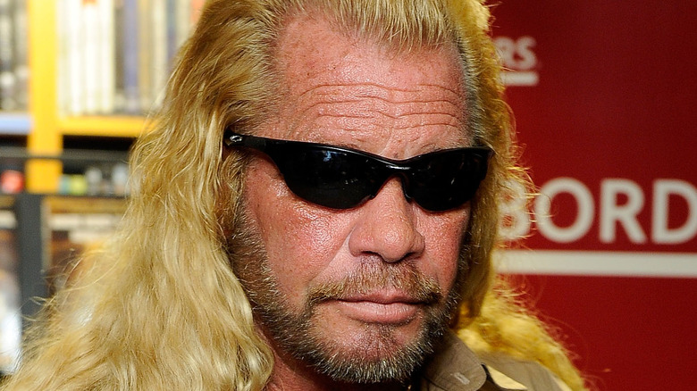 Dog the Bounty Hunter poses at an event