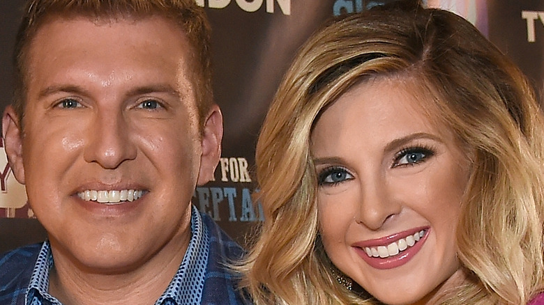 Todd and Lindsie Chrisley pose together