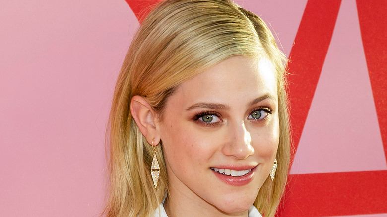 Lili Reinhart with her hair tucked behind her ear
