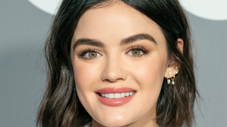 Lucy Hale smiling for press