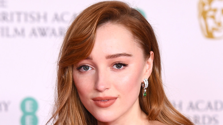 Phoebe Dynevor poses on the red carpet