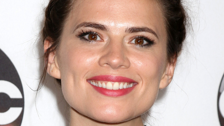 Hayley Atwell smiling for the camera at an event