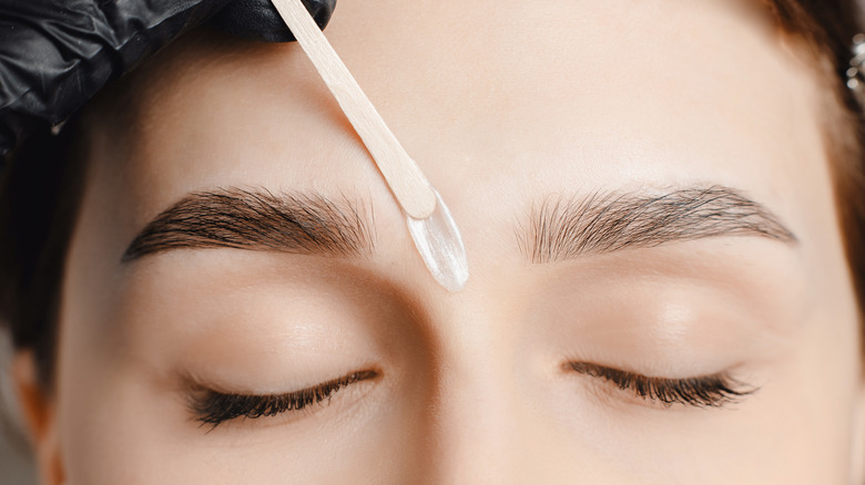 Wax applied between eyebrows