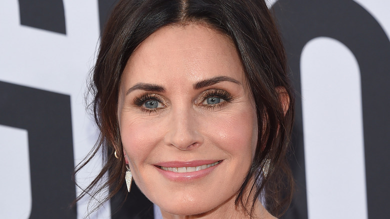 Courteney Cox smiles at an event