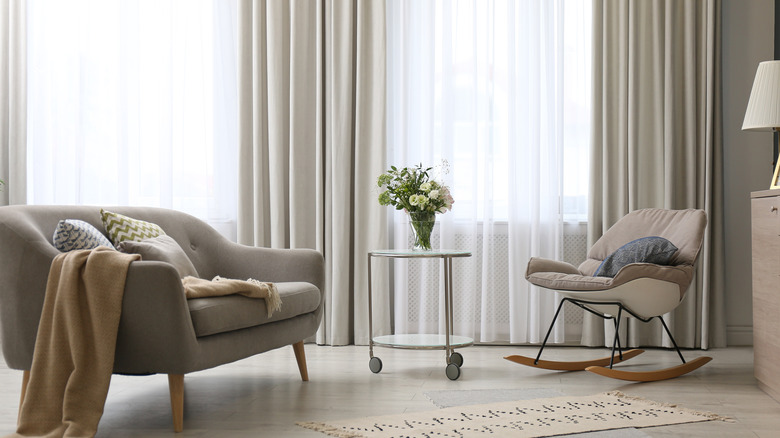 Living room with multiple styles of fabric