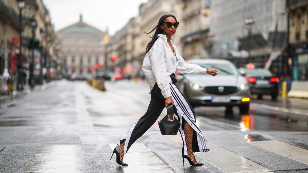 Woman wearing snap up sweats and heels