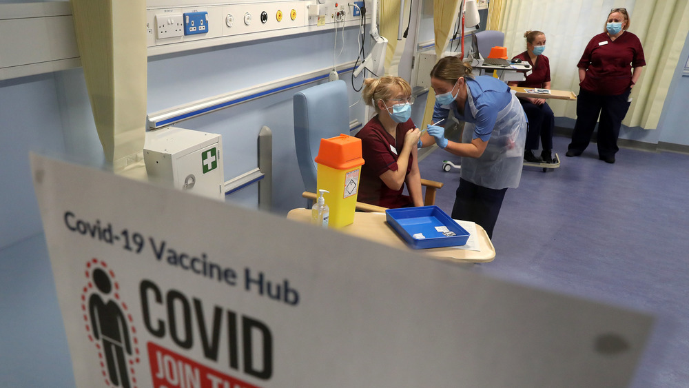 British health workers receive the COVID-19 vaccine