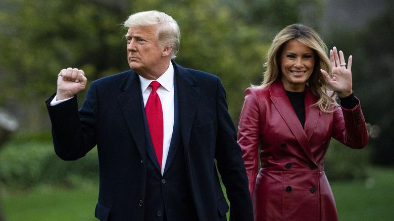 Donald and Melania Trump walking and waving