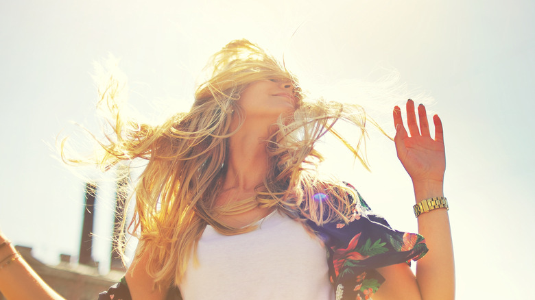 Woman aglow under the summer sun